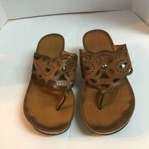 Clark's leather thong open toe wedge heel sandals.